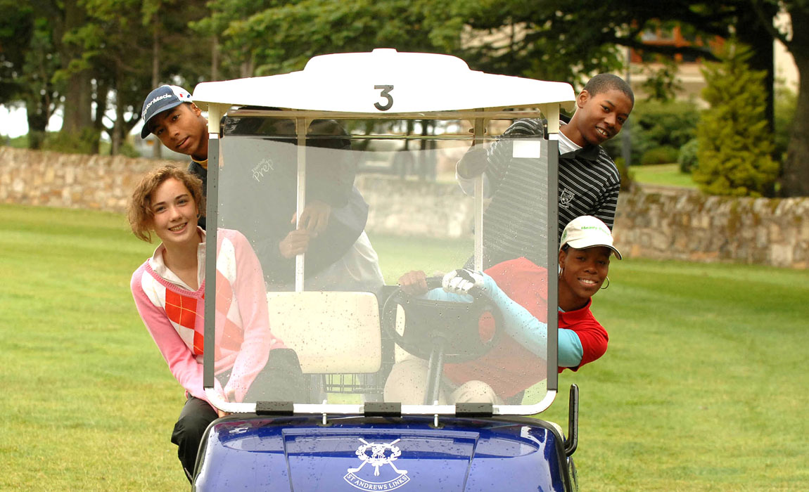 New Links participants in a golf buggy